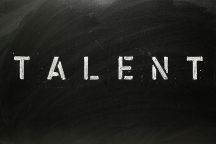 The word TALENT in stencil letters on a blackboard